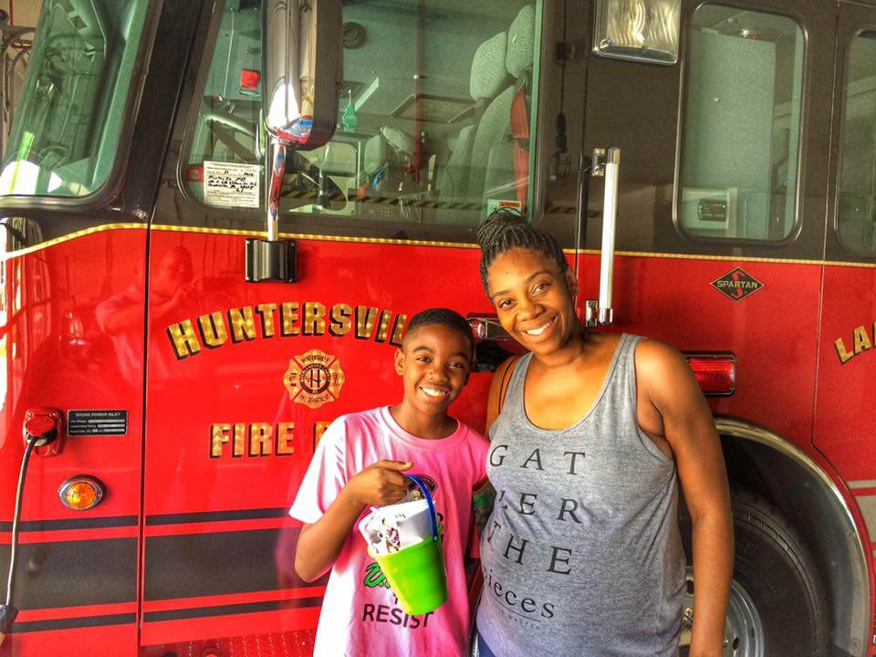 YOUNG RESIDENT STOPS BY STATION 1